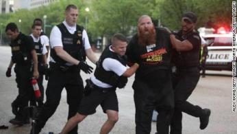 Image result for SECRET POLICE INTERFERE THE FIGHT BETWEEN FLAG BURN