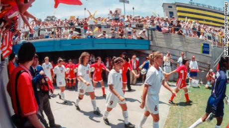 Members of the USA and China national teams enter the field prior to the final game of the 1999 FIFA Women's World Cup at the Rose Bowl in Pasadena, California.