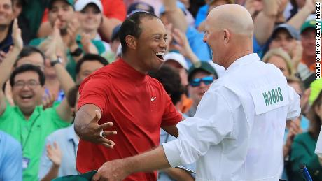 Tiger Woods celebrates with caddie Joe LaCava after winning the 2019 Masters at Augusta.