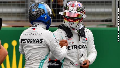 Lewis Hamilton congratulates Valtteri Bottas on his pole position.