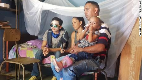 Rufo Chacon with his family at his home in Tariba, Tachira, Venezuela.