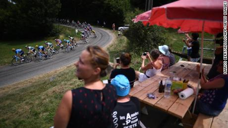 Fans cheer riders from the roadside between Albi and Toulouse during last year's Tour.