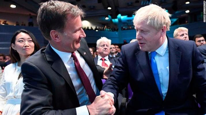 Jeremy Hunt (left) congratulates Boris Johnson after the announcement of the result on July 23.