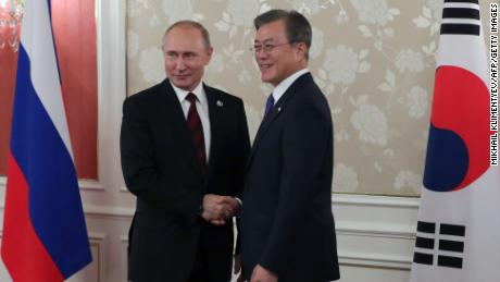 Russian President Vladimir Putin and South Korea's President Moon Jae-in hold a bilateral meeting on the sidelines of the G20 summit in Osaka on June 28.