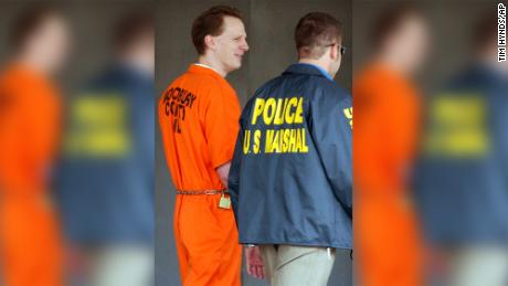 Dustin Honken is led by US marshals from the federal building in Sioux City, Iowa, on October 27, 2004.