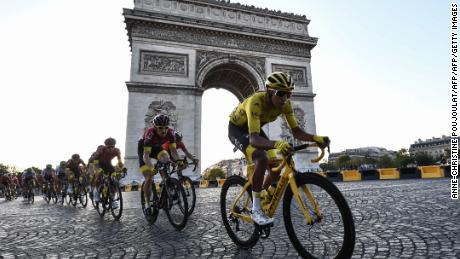 Colombia's Egan Bernal rides down the Champs Elysees alongside the Arc de Triomphe.