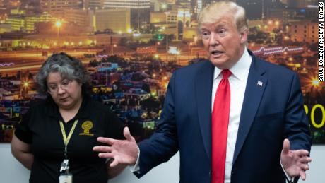 Trump gripes about his critics while at the scene of tragedy