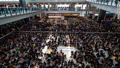 Hong Kong airport shutdown: What it means for business and the economy