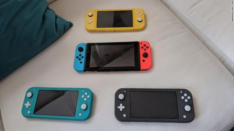 The Nintendo Switch Lite is pictured here alongside the original Switch.