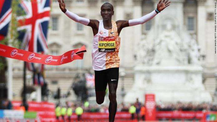 Eliud Kipchoge crosses the finish line during the London Marathon