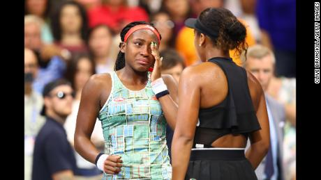 Osaka consoles Gauff (left) after their match at the US Open.