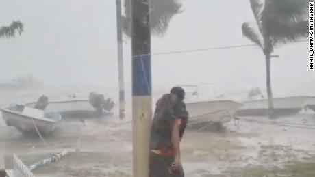 A man is caught out in the elements as Hurricane Dorian lashes the Bahamas.