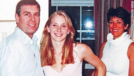 A photo appears to show Prince Andrew with Jeffrey Epstein accuser Virginia Roberts Giuffre and Ghislaine Maxwell in the background.