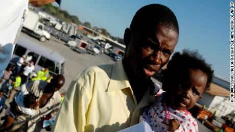 Unidentified evacuees board a relief flight to Chicago from earthquake-ravaged Port-au-Prince, Haiti, in January 2010.