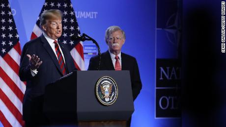 Trump signs Uyghur human rights bill on same day Bolton alleges he told Xi to proceed with detention camps