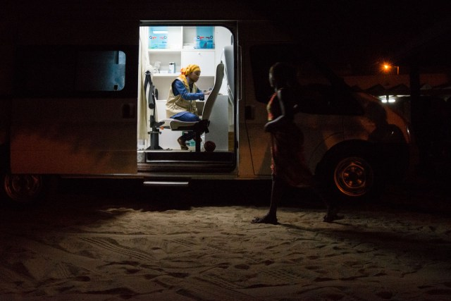 A clandestine sex worker approaches the Enda Santé mobile clinic for a check-up with a doctor