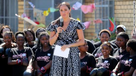 Meghan, Duchess of Sussex makes a speech as she visits a Justice Desk initiative in Nyanga township, with Prince Harry.