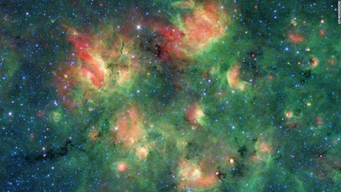 This infrared image from NASA's Spitzer Space Telescope shows a cloud of gas and dust full of bubbles, which are inflated by wind and radiation from massive young stars. Each bubble is filled with hundreds to thousands of stars, which form from dense clouds of gas and dust.