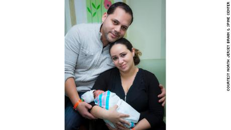 Lucas, seen here with parents Augusto and Maria Santa Maria, is developing much like other children his age, Dr. Tim Vogel said.