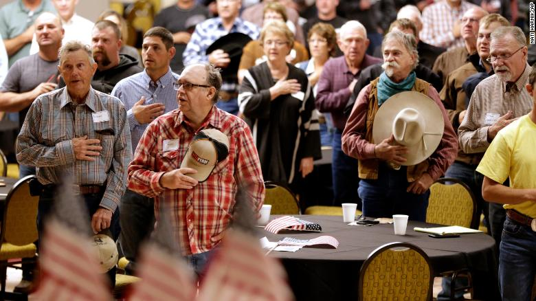 The Pledge of Allegiance is recited in Omaha, Nebraska, at the start of a meeting to urge President Trump to ensure fair prices for cattle farmers and ranchers.