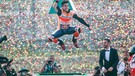Marc Marquez jumps for joy as he celebrates his eighth world motorcycling title and sixth MotoGP crown.