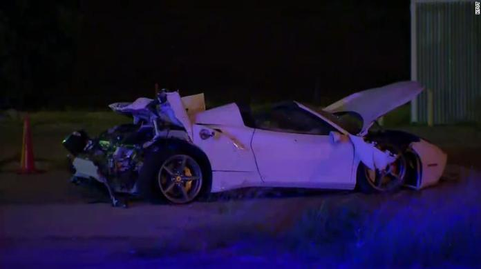 The boxer was ejected from the Ferrari after it flipped, police say.