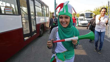 An Iranian woman wearing her country's national colours arrives at the Azadi stadium.