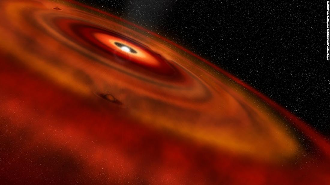This is an artist's illustration of gas and dust disk around the star HD 163296. Gaps in the disk are likely the location of baby planets that are forming.