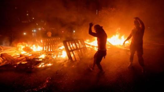 Lebanese demonstrators burn wood and debris on Thursday, October 17.