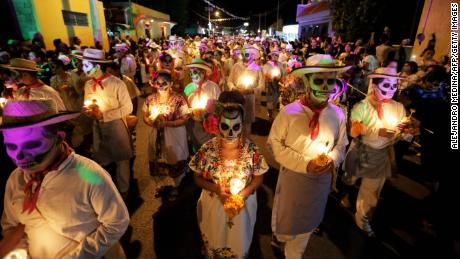 The Day of the Dead parades and costumes are meant to celebrate life rather than be spooky.