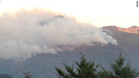 The Kincade Fire burns in the hills near Middletown in California's Lake County on Tuesday.