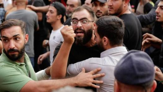 Anti-government protesters and Hezbollah supporters clash on Friday, October 25.