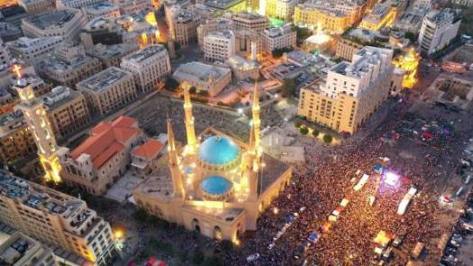 An aerial view shows thousands of Lebanese protesters gathered in Beirut's downtown district on Sunday.