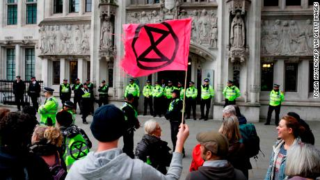 Climate activists protest outside the Supreme Court, during the eleventh day of demonstrations by the climate change action group Extinction Rebellion, in London, on October 17, 2019.