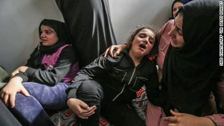 Lian (C) daughter of Baha Abu Al-Ata mourns during his funeral in Gaza City on November 12.