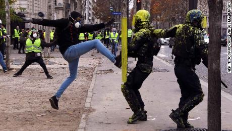 A demonstrator clashes with riot police in Paris, on December 1, 2018.