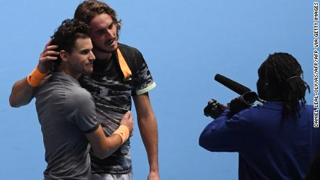 Stefanos Tsitsipas and Dominic Thiem (front) exchange a hug after their ATP Finals thriller.