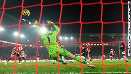 Oli McBurnie's fine ha afferrato un drammatico punto di per lo Sheffield United.