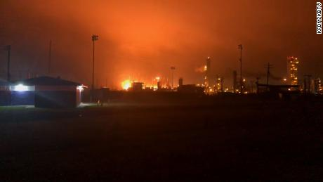 Fire illuminates the sky after a blast at a chemical plant in Port Neches, Texas.