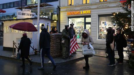Tourists take photos of actors dressed as soldiers at the former Checkpoint Charlie in Berlin, where American and Soviet tanks clashed in the early years of the Cold War.
