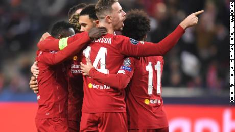 Naby Keita of Liverpool celebrates with Jordan Henderson and team mates after he scores during the 2-0 win at Salzburg.
