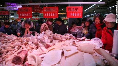 China cuts some tariffs to boost trade and take heat out of pork prices