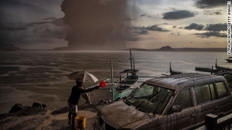 A vehicle covered in ash mixed with rainwater after Taal Volcano erupted on January 12, 2020 in Talisay, Philippines.