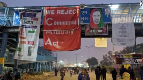 Posters against the Citizenship Amendment Act (CAA) hang from an overpass in Shaheen Bagh, New Delhi, on January 13, 2020.