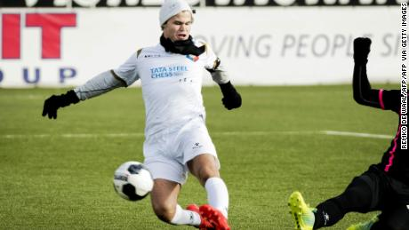 Carlsen is pictured playing football in Velsen-Zuid before a chess tournament in 2017.