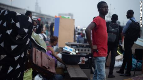 A boy looks on as Tarkwa Bay residents pack their belongings on boats on Tuesday. Photo: Omoregie Osakpolor