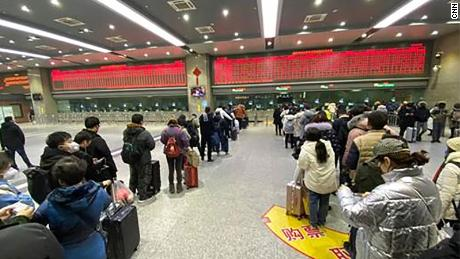 People in a ticket line trying to get out of Wuhan in Wuchang train station in China.