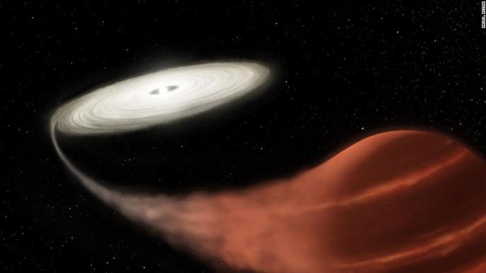 A white dwarf, left, is pulling material off of a brown dwarf, right, about 3,000 light-years from Earth.