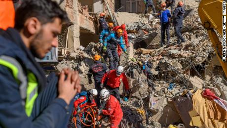 Rescue workers search through the rubble in Elazig on Saturday.