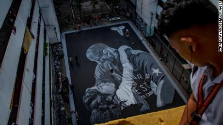 A giant mural of former NBA star Kobe Bryant and his daughter Gianna, painted hours after their death, is seen at a basketball court on January 28, 2020 in Taguig, Metro Manila, Philippines.